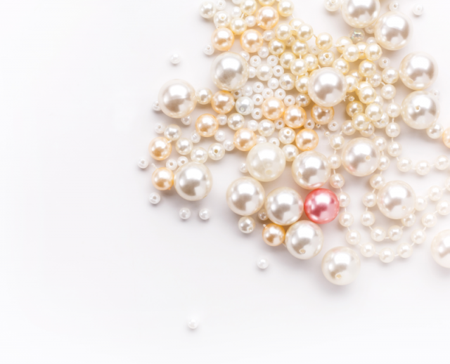 multicoloured pearls on light background