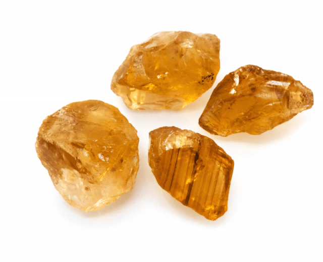 amber topaz crystals on white background